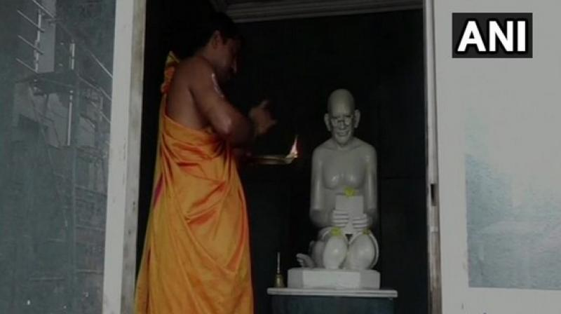 Prayers, along with tea, coffee and bananas, are rendred to Gandhi's idol by the temple priest at Shri Bramha Baidarkala Kshetra, three times a day. (Photo: ANI)