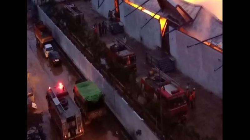 As many as six fire tenders rushed to the spot and firemen are attempting to douse the flames. (Photo: ANI)