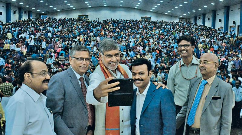SRM president Dr P. Sathyanarayanan appears happy and proud to pose for a selfie with Nobel Peace Laureate Kailash Satyarthi during a huge conference held at the SRM's Kattankulathur campus on Monday. Several hundred school children were part of this massive interactive exercise with Satyarthi, a globally acknowledged campaigner for child rights. 	— DC