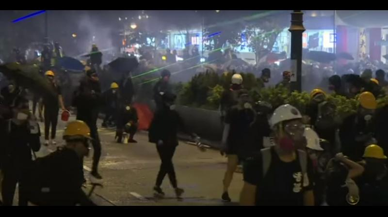 Hong Kong police fired volleys of tear gas to disperse anti-government protesters on Saturday - sending tourists fleeing weeping in Kowloon - only for demonstrators to regroup and gather elsewhere during another tense, hot and restive weekend. (Photo: AFP/ video screengrab)