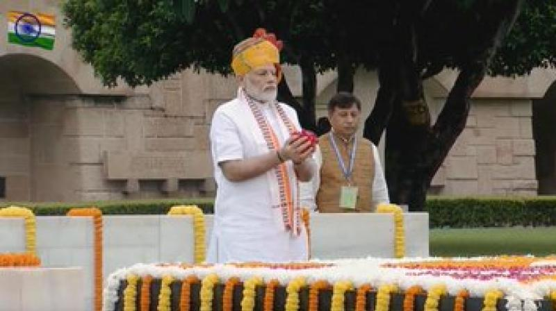 Prime Minister Narendra Modi paid homage to Mahatma Gandhi at the Rajghat on the occasion of Independence Day on Thursday, prior to the flag hoisting at the Red Fort. (Photo: Twitter/ ANI)