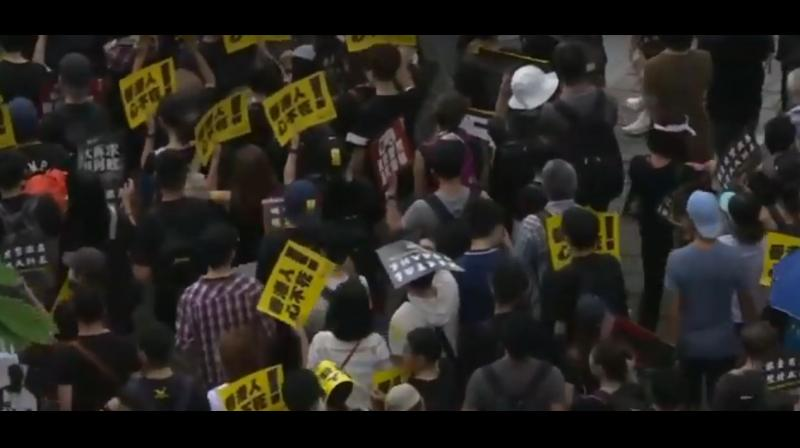 Hundreds of thousands of protesters carrying umbrellas poured across the heart of Hong Kong island defying torrential rain and a police order not to march from a park where they had gathered earlier for a rally. (Photo: AFP/ video screengrab)