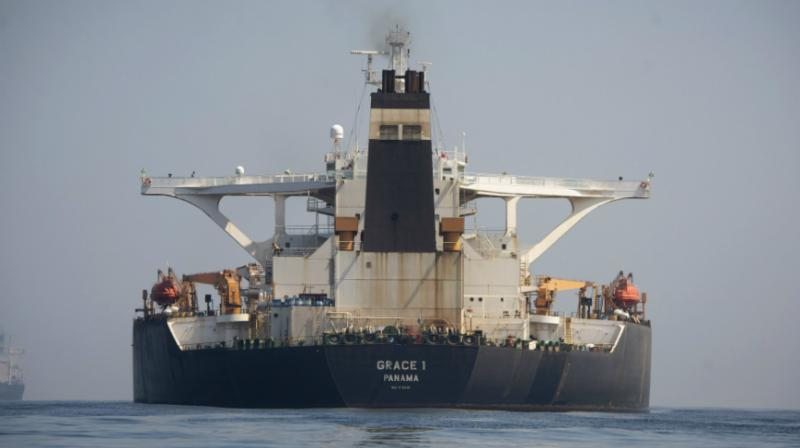 An Iranian supertanker hauling USD 130 million worth of light crude oil that the US suspects to be tied to a sanctioned organization has lifted its anchor and begun moving away from Gibraltar, marine traffic monitoring data showed late Sunday. (Photo: AP)