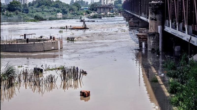 Water level in the Yamuna river on Tuesday morning crossed 'danger mark' as Haryana released more water from Hathni Kund barrage. (Photo: ANI)