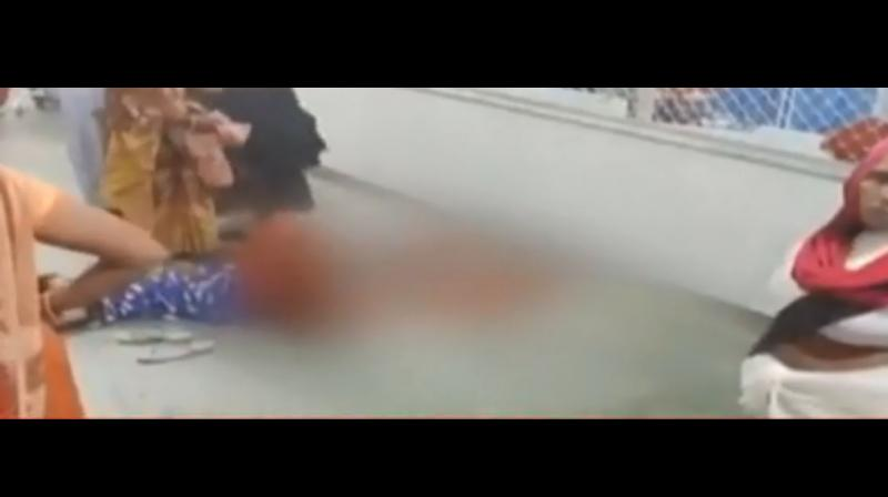 The horrific visuals of the woman lying in the hospital corridor with blood all around her can be seen in the video shot on a mobile camera. (NDTV/ youtube video screen)