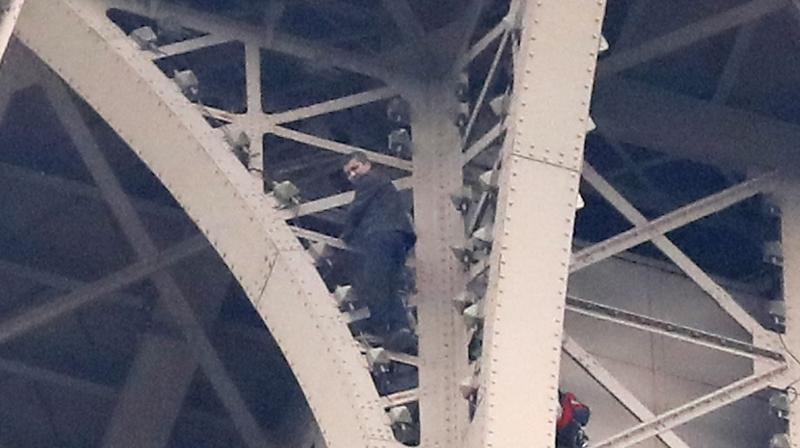 Police have made contact with the climber but do not yet know why he began his ascent up the iron beams. (Photo:AP)