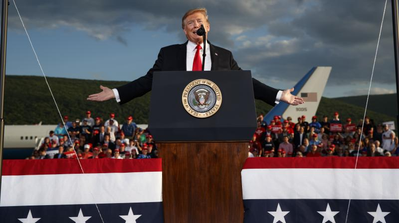 """We've got to win tomorrow, Fred,"" Trump told a cheering rally crowd at a hangar at Williamsport Regional Airport. (Photo:AP)"