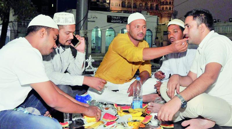Muslims break fast on the first day of the month of Ramzan at Macca Masjid in Hyderabad on Thursday. (Image: P. Surendra)