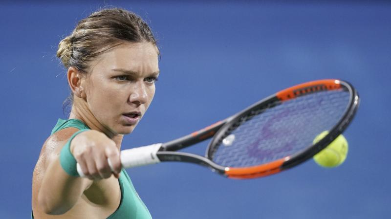 Halep has played in 15 tournaments so far in 2018, but she followed up her first major title by losing in the third round at Wimbledon. She then lost in the first round at the U.S. Open. (Photo: AP)