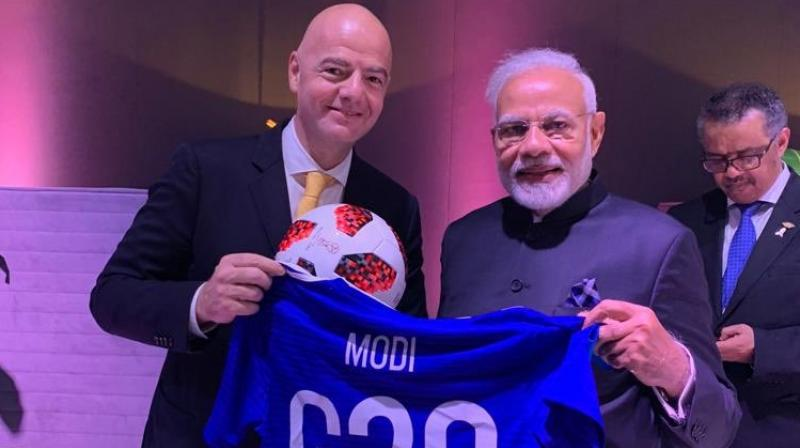 Modi, who met Infantino on the sidelines of the G-20 Summit in Buenos Aires on Saturday, shared a picture of the blue jersey, with his name on the back, on Twitter. (Photo: Twitter)