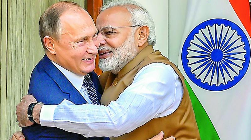 Prime Minister Narendra Modi hugs Russian President Vladimir Putin before their meeting at Hyderabad House, in New Delhi, on Friday. (Photo:PTI)
