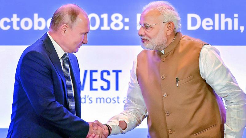 Hugs as Putin touts missiles in India