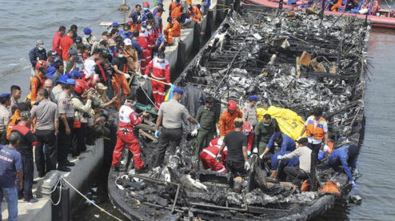 The Zahro Express was carrying at least 247 people, mostly Indonesians celebrating the New Year's holiday, from Muara Angke port in northern Jakarta to the resort island of Tidung when it caught fire. (Photo: AP)
