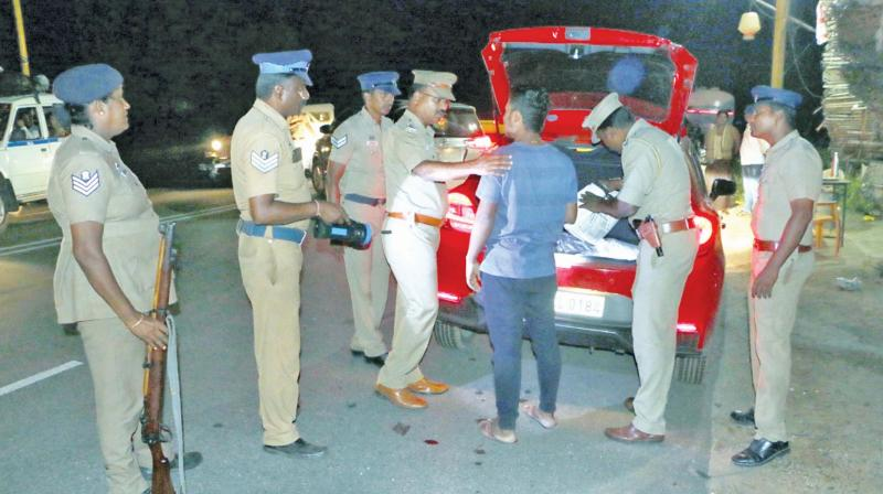 Police at a check-post at Christianpettai near Vellore close to the AP border examining the boot of a car late Saturday night. (Photo: K. Senthil Nathan)