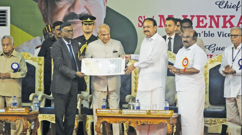 Vice President M. Venkaiah Naidu released a commemorative stamp and special cover brought out by the postal department on the occasion of the  150th birth anniversary of Dharmamurthi Rao Bahadur Calavala Cunnam Chetty, at the University Centenary auditorium in the city on Saturday. Governor Banwarilal Purohit also seen. (Photo: DC)