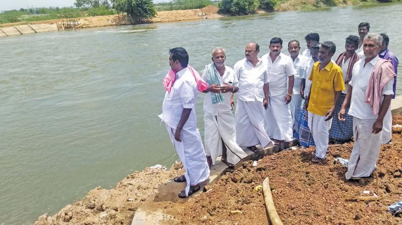 S.S.Palanimanickam, Thanjavur MP, former union  minister at Kalvirayanpettai near Thanjavur on Saturday where a retaining wall has been built to plug a breach that occured last year in the GA canal. (Photo: DC)
