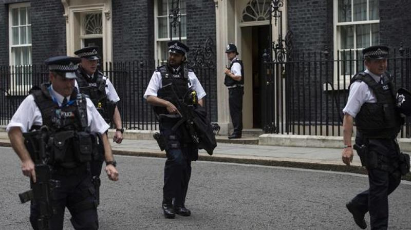 Armed British police officers patrol near 10 Downing Street, the official residence of British Prime Minister. (Photo: Representational Image/AFP)