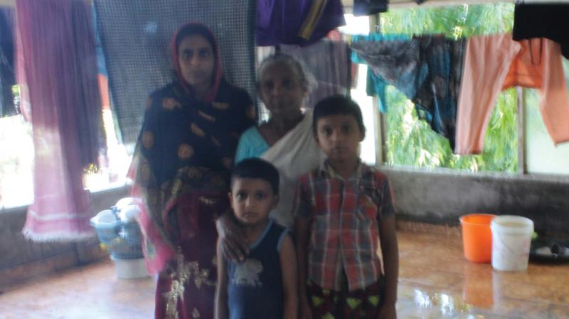 Sajna and her children along with Vasundhara at the rooftop of the former Purakkad panchayat building on Saturday