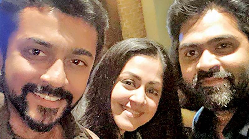 Jyothika with hubby Suriya and fan Simbu.