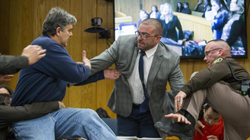 Father who lunged at Nassar in court: 'I lost control'