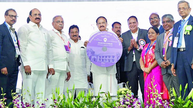 Vice-President M. Venkaiah Naidu releases theme song of Rangaraya Medical College during the college Diamond Jubilee celebrations in Kakinada on Saturday. Home minister N. Chinarajappa and others are seen.