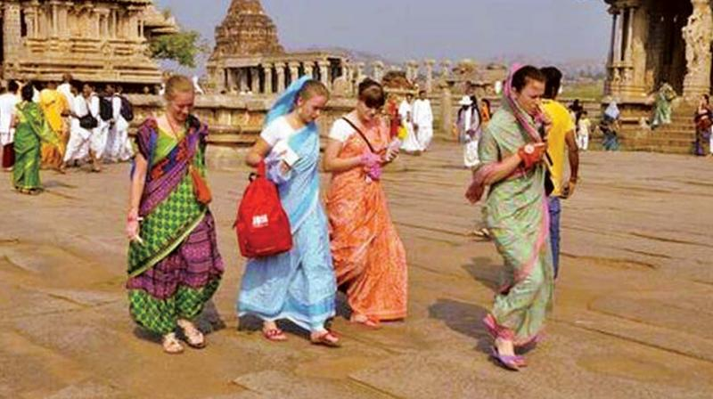 A file photo of foreigners clad in saris at Hampi.