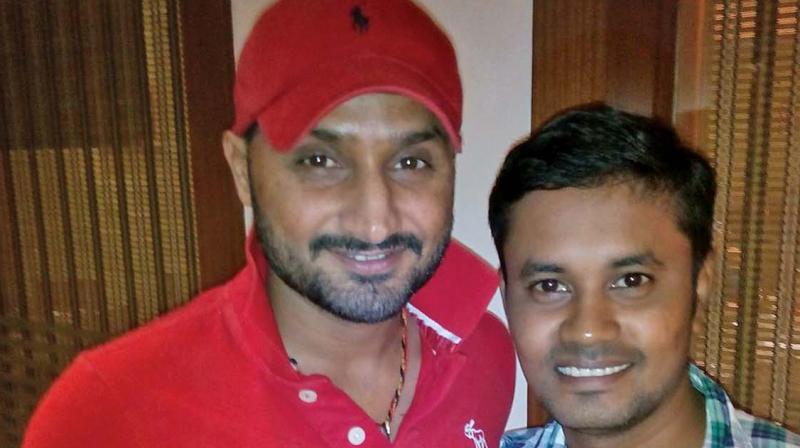 Harbhajan Singh with his fan.
