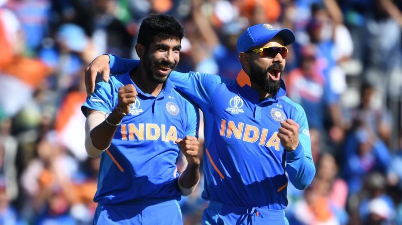 Virat Kohli and Jasprit Bumrah. (Photo: AFP)