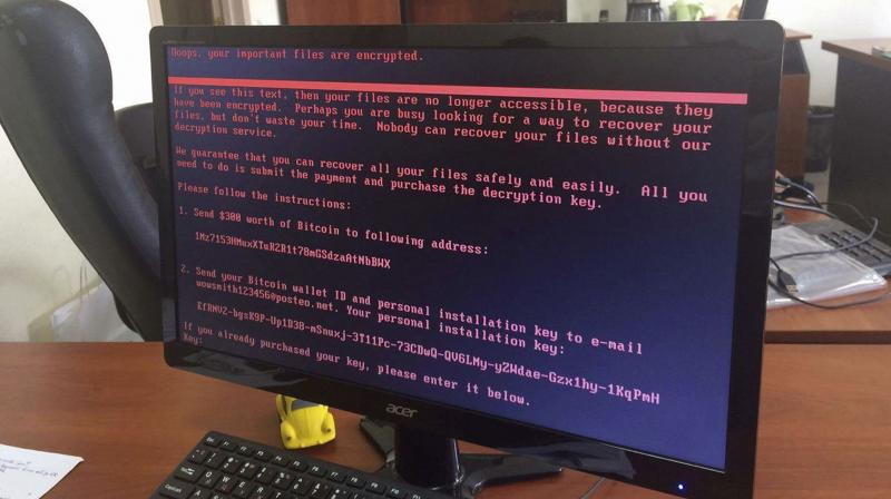 A computer screen cyberattack warning notice reportedly holding computer files to ransom, as part of a massive international cyberattack, at an office in Kiev, Ukraine. (Photo: AP)