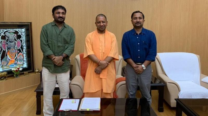 Anand Kumar with UP CM Yogi Adityanath. (Photo: ANI)