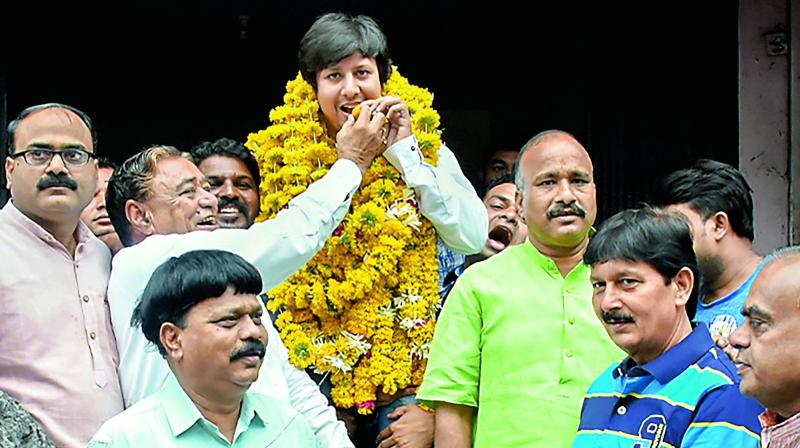 BJP MLA Akash Vijayvargiya is garlanded after being released from the district jail. (Photo: AP)
