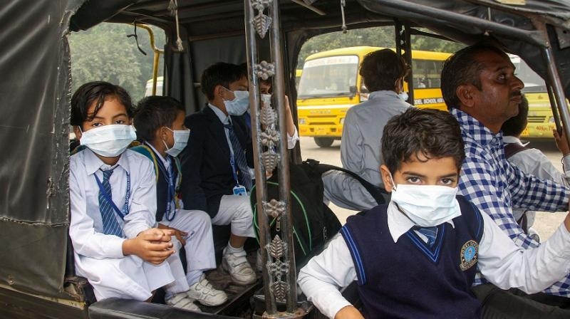 Pictures of school students with their faces covered with anti-pollution masks and handkerchiefs were shared widely on social media. (Photo: PTI)