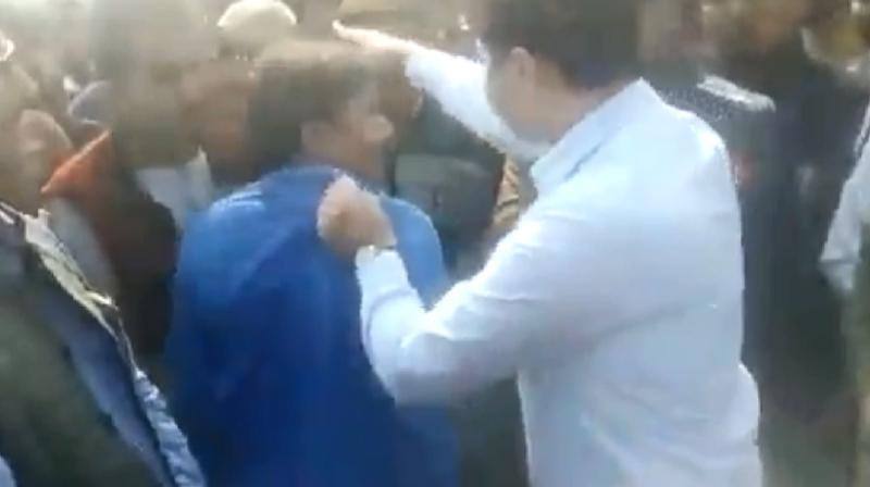 The DM was seen almost dragging him holding his shirt and asking him if he could make out if anyone in the crowd had a gun. (Photo: Screengrab)