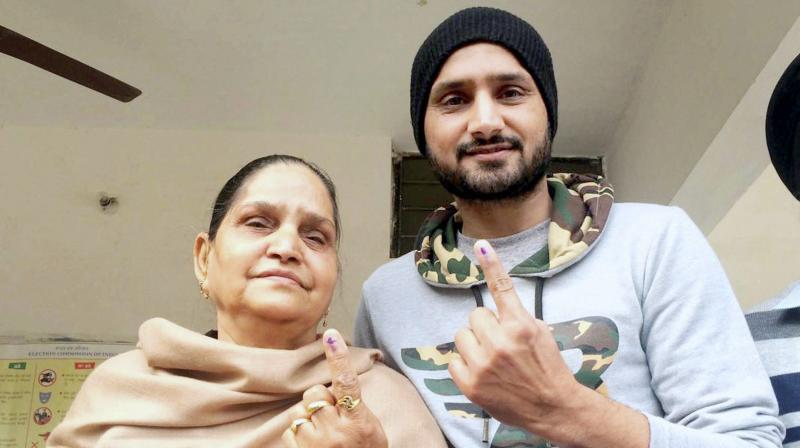 Harbhajan Singh and his mother after casting their votes at a polling station in Jalandhar. (Photo: PTI)