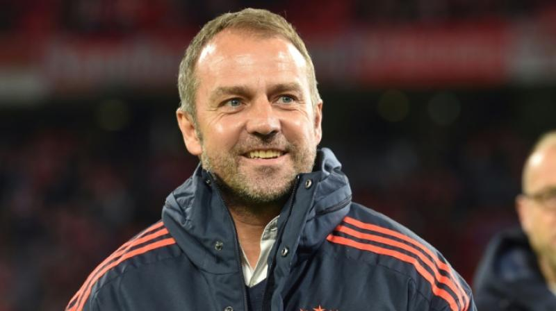 Bayern Munich's interim coach Hansi Flick was to be in charge for only two matches but club CEO Karl-Heinz Rummenigge said on Saturday he would remain until further notice after the side's 4-0 demolition of Bundesliga title rivals Borussia Dortmund. (Photo:AFP)