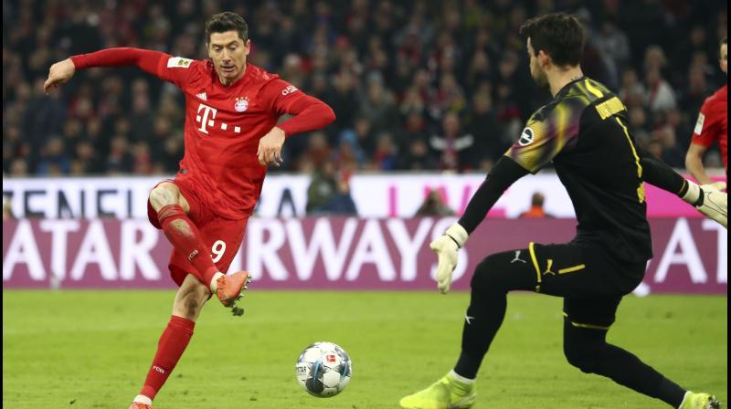 anagerless Bayern Munich thrashed Borussia Dortmund 4-0 in 'Der Klassiker' as Robert Lewandowski continued his phenomenal scoring run with two goals at the Allianz Arena. (Photo:AP)