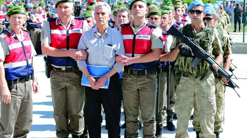 Paramilitary police and members of the special forces escort former Air Force commander Akin Ozturk and others in a failed coup in 2016, in Ankara. (Photo: AP file)