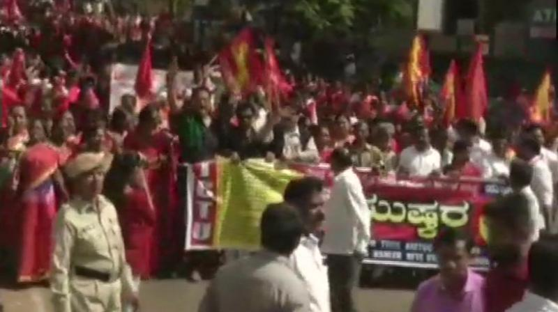 The 10 central trade unions (CTUs) which have given a call for the two-day Bharat Bandh are protesting the government's snub of their 12-point charter of demands seeking minimum wage of Rs 18,000, social security for all workers and issue related to price rise. (Photo: ANI | Twitter)