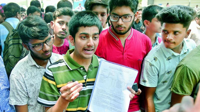 Intermediate students outside the Board of Intermediate office in Nampally on Wednesday seeking clarification on the lapses that led to many students failing in the exams. (Photo: S. Surender Reddy)