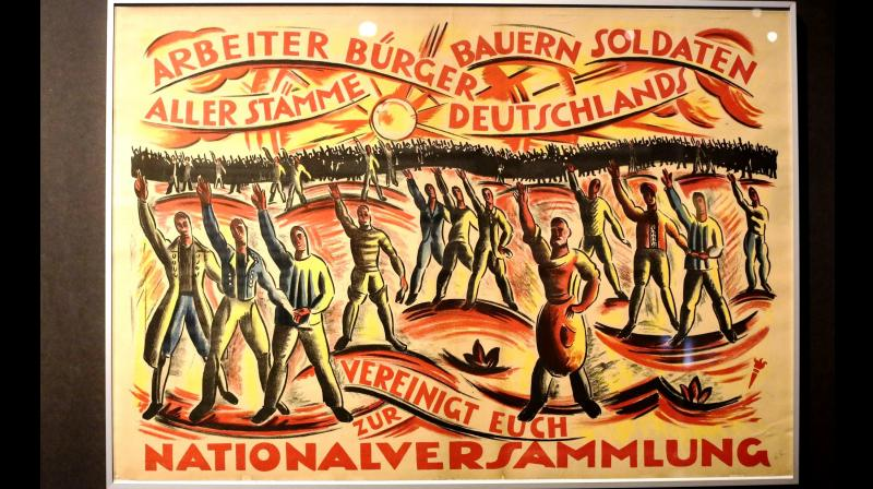 A historic poster is displayed at the exhibition, reads: ' Workers, Citizen, Farmer, Soldiers of all German tribes united for the National Assembly.' (Photo: AP)