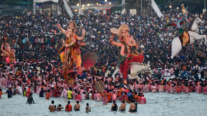 Devotees carried idols of Lord Ganesh for immersion in rivers and lakes across Maharashtra on Sunday morning, marking the culmination of the 11-day festival. (Photo: Rajesh Jadhav)