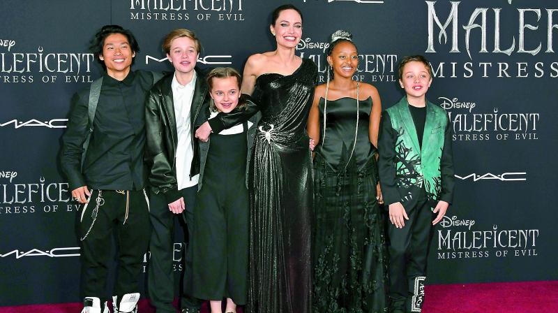 While Jolie's oldest child, Maddox, is off at college in South Korea, his younger siblings showed their support for their mom at the El Capitan Theatre in Los Angeles.