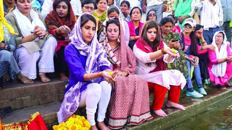 Congress MLA from Rae Bareli Aditi Singh, who was attacked three days ago, offers prayer at Dashashwamedh Ghat in Varanasi on Friday. (Photo: PTI)