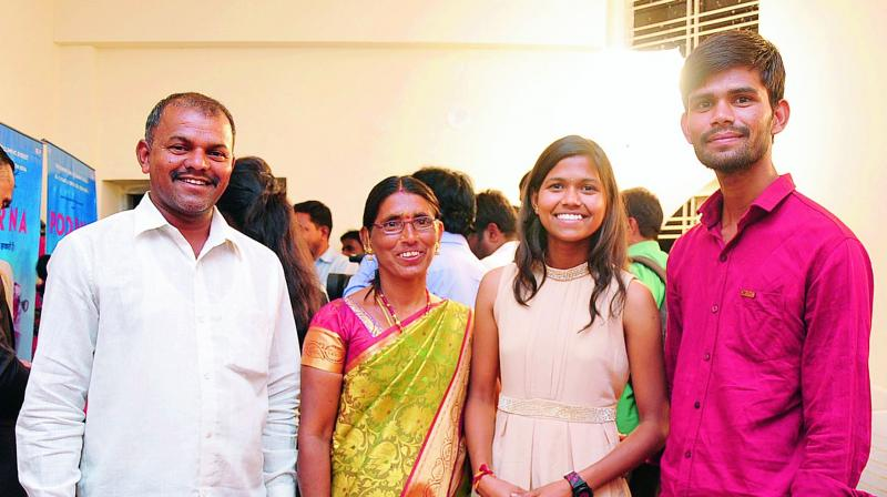Happy family: Poorna Malavath along with her parents Devi Das, Laxmi and brother Naresh.