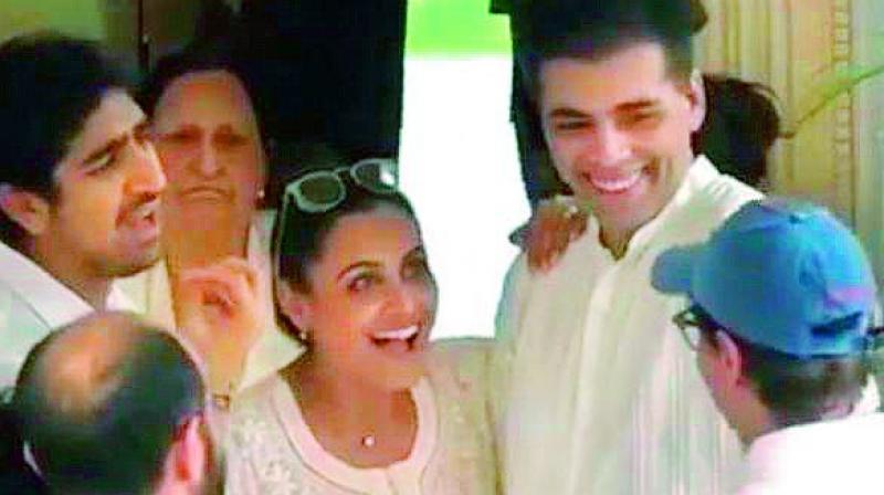 Rani Mukherji, Karan Johar and Ayan Mukerji were snapped having a lighthearted conversation at Krishna Kapoor's funeral