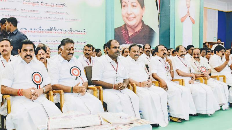 CM Edappadi K. Palaniswami and Deputy CM O. Panneerselvam greet party cadres  during the consultative meeting organised ahead of Thiruparankundram by-election, at Madurai, on Thursday. 	  Image; DC