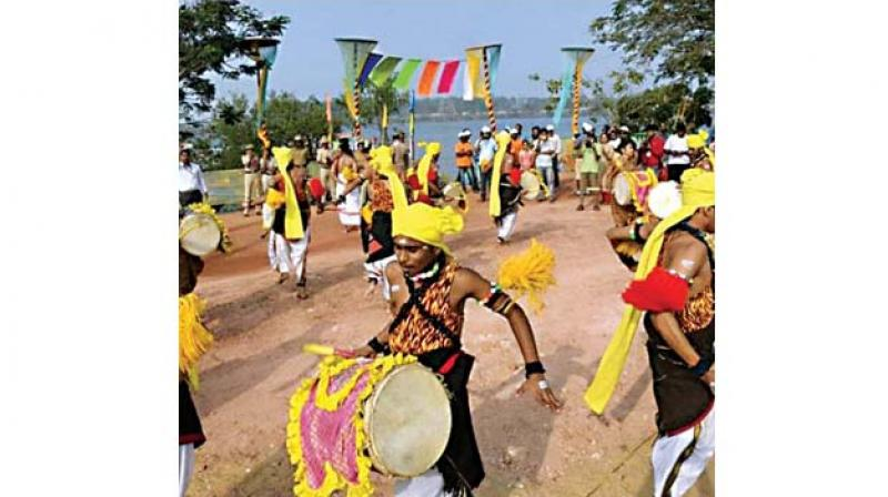 Folk artistes perform at the inauguration of the two-day river festival in Mangaluru on Saturday.