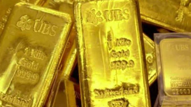 Globally, gold prices traded higher at USD 1293.61 an ounce and silver advanced to USD 15.75 an ounce in New York.