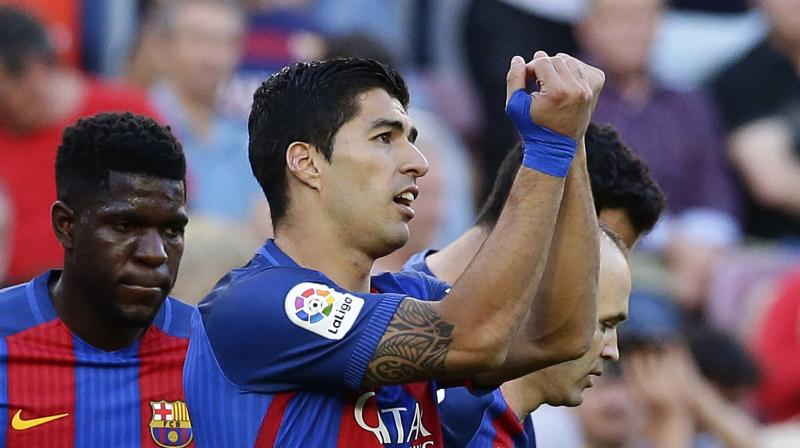 Luis Suarez took the MSN tally to 101 and killed the game off as a contest when he turned Jaume Costa and fired low and hard past Fernandez. (Photo: AP)