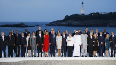 Group of Seven leader and guests pose for the G7 family photo Sunday, Aug. 25, 2019 in Biarritz. (Photo: AP)